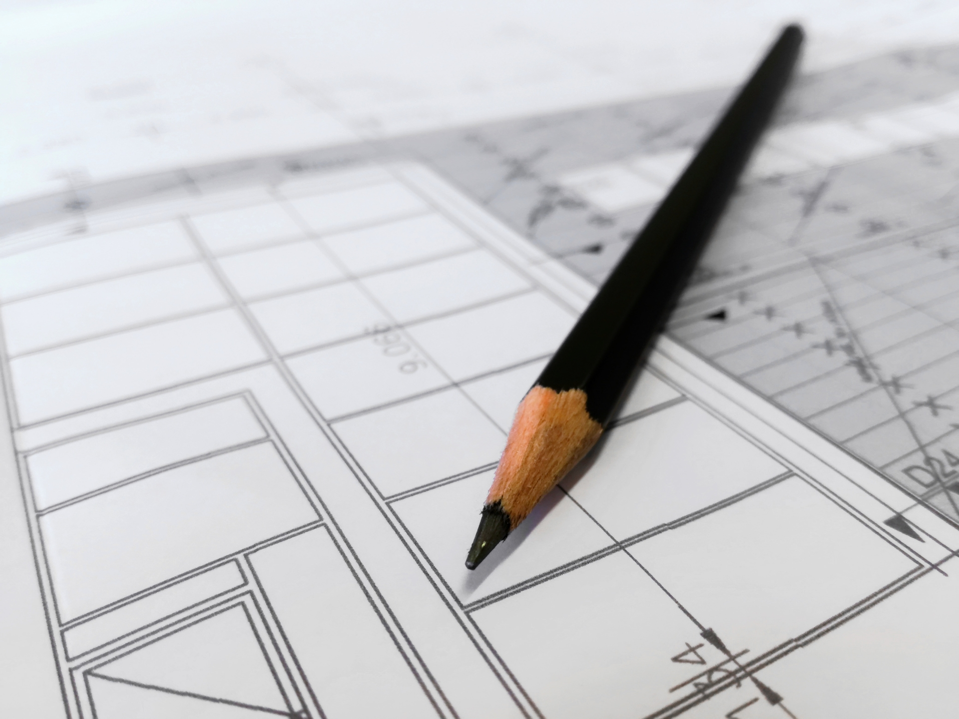 A pencil and plans for house building